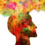 Colorful silhouette of head with equally colorful cloud emerging from its top