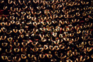 Overhead shot of crowd of graduates in gowns